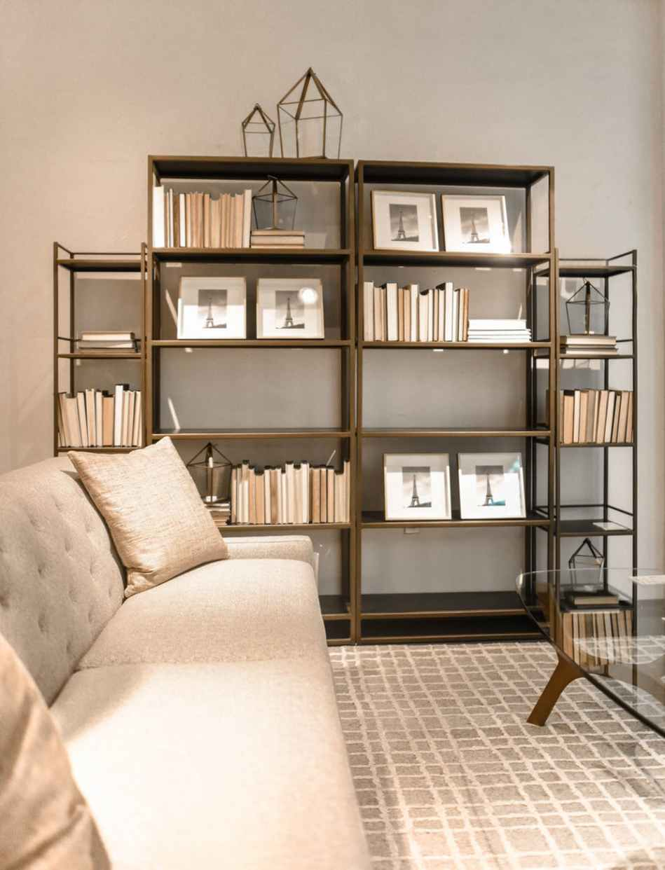 brown wooden shelf and beige fabric sofa